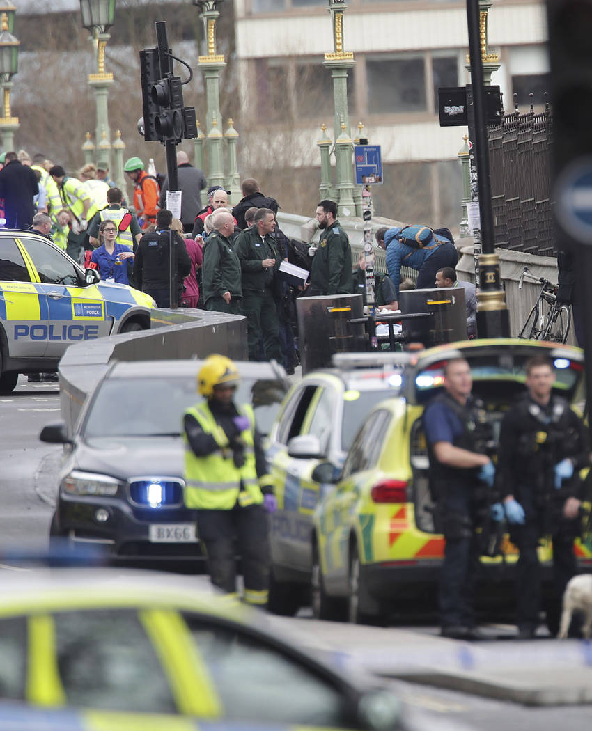 Emergency personnel close to the Palace of Westminster, London, Wednesday, March 22, 2017, after London police say officers called to a 'firearms incident' on Westminster Bridge, near Parliament.  ...