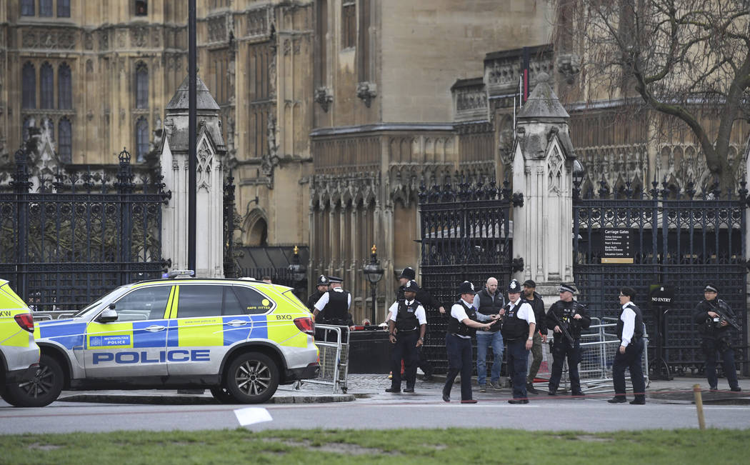 Police on the scene after sounds similar to gunfire have been heard close to the Houses of Parliament, London, Wednesday, March 22, 2017. The UK House of Commons sitting has been suspended as witn ...