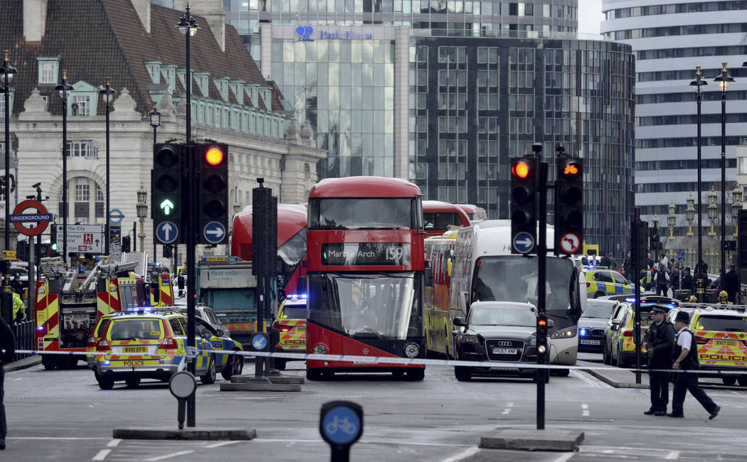 Roads are closed off by police after sounds similar to gunfire have been heard close to the Houses of Parliament, London, Wednesday, March 22, 2017. The UK House of Commons sitting has been suspen ...