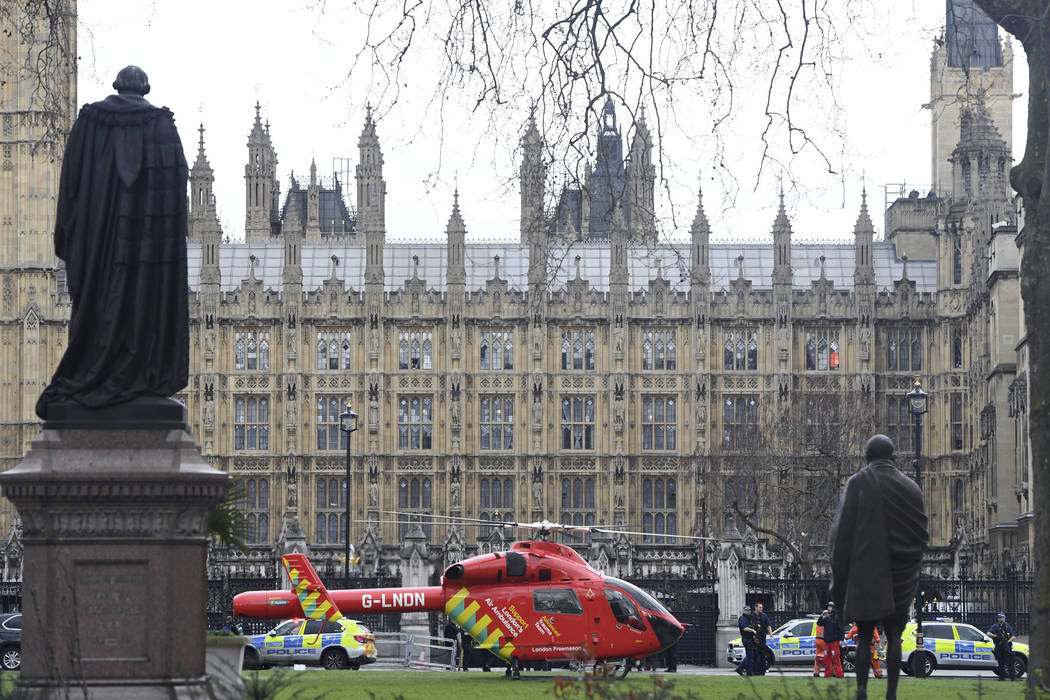 An Air Ambulance on the scene after sounds similar to gunfire have been heard close to the Houses of Parliament, London, Wednesday, March 22, 2017. The UK House of Commons sitting has been suspend ...