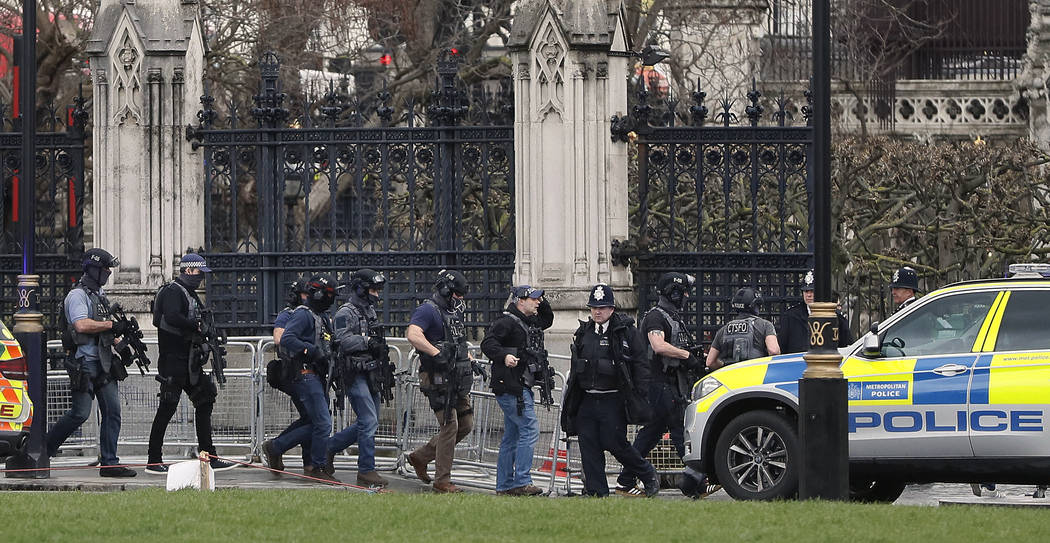 Armed police officers enter the Houses of Parliament in London, Wednesday, March 23, 2017, after the House of Commons sitting was suspended as witnesses reported sounds like gunfire outside. (Kirs ...