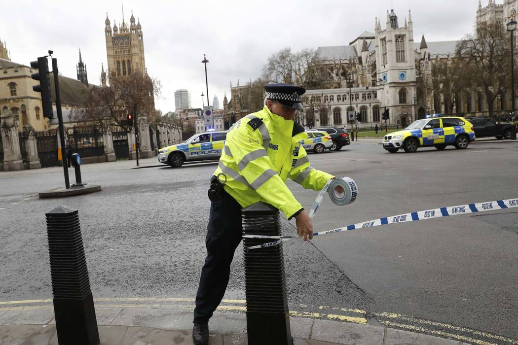 Police tapes off Parliament Square after reports of loud bangs in London, March 22, 2017. (Stefan Wermuth/Reuters)