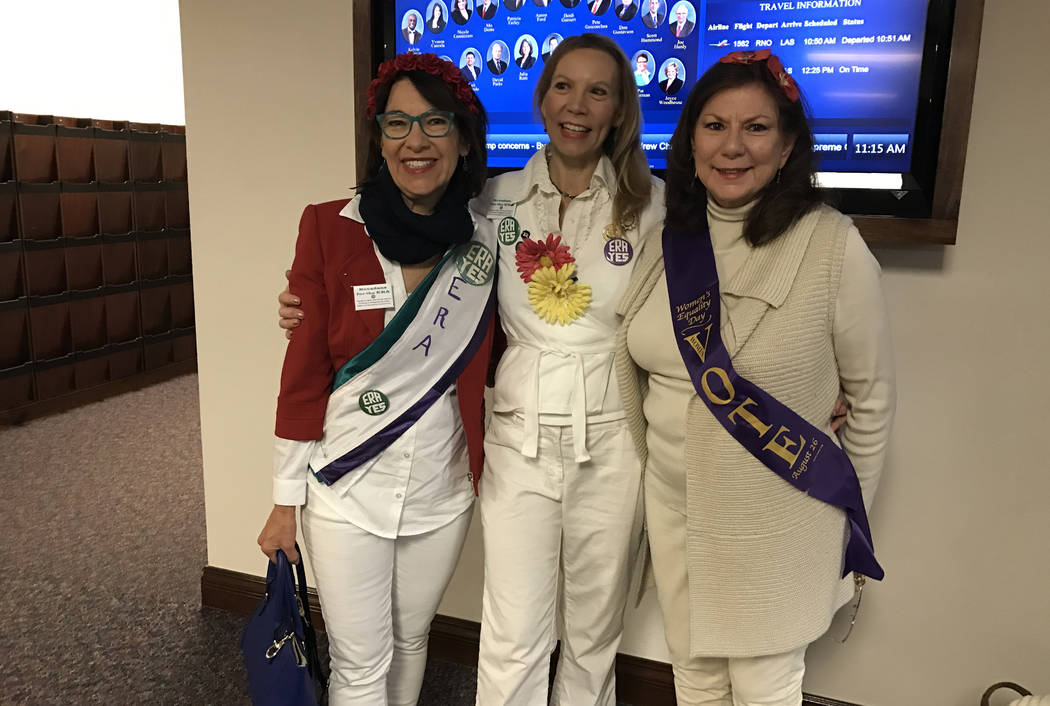 From left, Sarah Mahler, Janette Dean and Pat Lynch, wore sashes and buttons Wednesday, March 22, 2017, in the state Legislature as the Nevada Senate prepared to give final approval to ratifying t ...