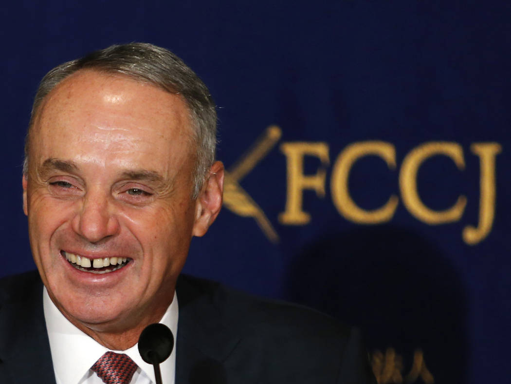 Major League Baseball Commissioner Rob Manfred laughs during a press conference in Tokyo, Tuesday, March 7, 2017. Manfred denied reports Tuesday that 2017 would be the last edition of the World Ba ...