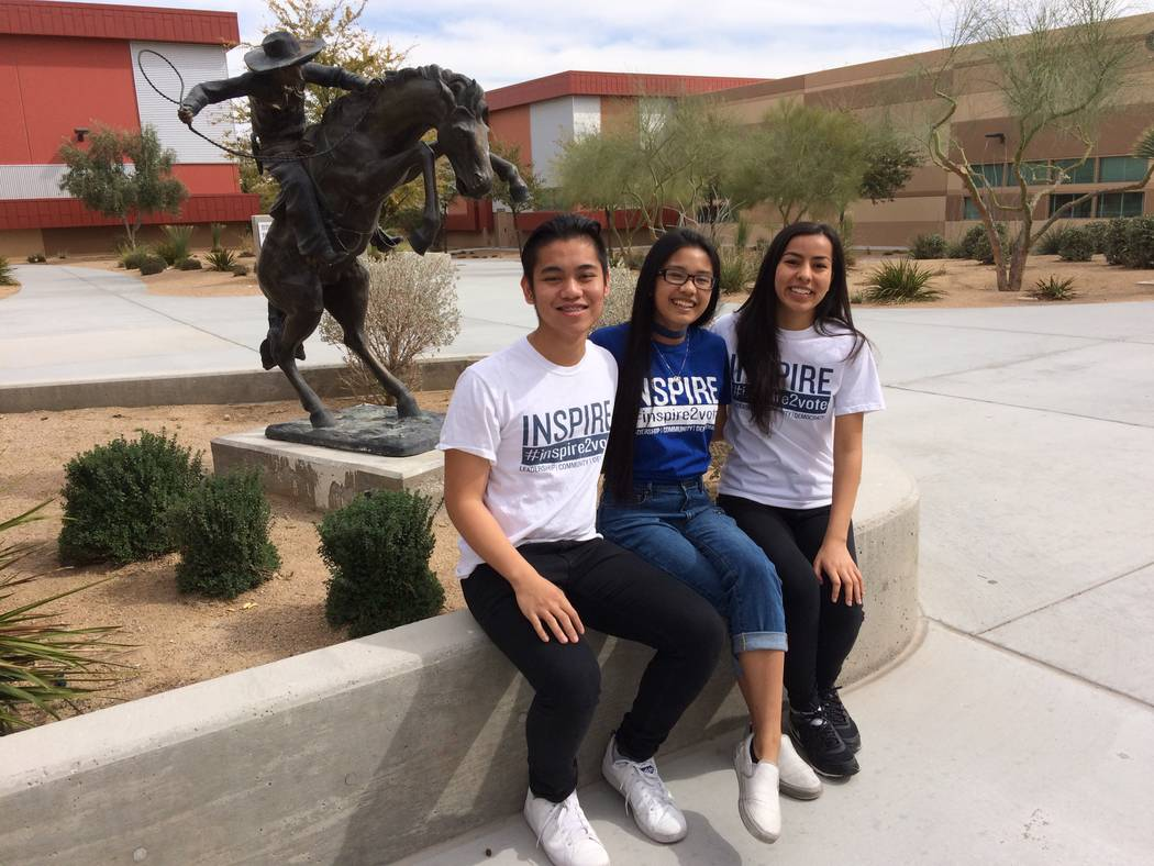 Jon Andre Parilla, Crysty-Ann Olaco and Ambika Verma, from left, talk March 10 about signing up fellow students to vote as they sit in the courtyard at West Career and Technical Academy, 11945 W.  ...