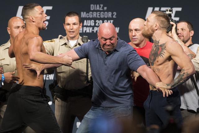 Nate Diaz, left, and Conor McGregor pose during UFC 202 weigh-in at the MGM Grand hotel-casino on Wednesday, Aug. 17, 2016, in Las Vegas. Erik Verduzco/Las Vegas Review-Journal Follow @Erik_Verduzco