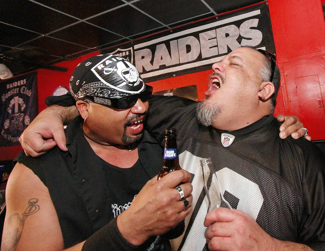 Damian Cisneros, left, and Sam Porras celebrate at Legends Sports Bar & Grill in Las Vegas after National Football League owners voted in Phoenix to approve the relocation of the Oakland Raide ...