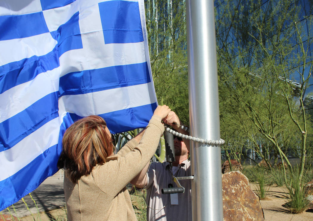 Las Vegas City Hall staff members tie the Greek flag onto a flag pole, Thursday, March 23, 2017. A flag raising ceremony was held to celebrate Greece's independence and the Greek community in Las  ...