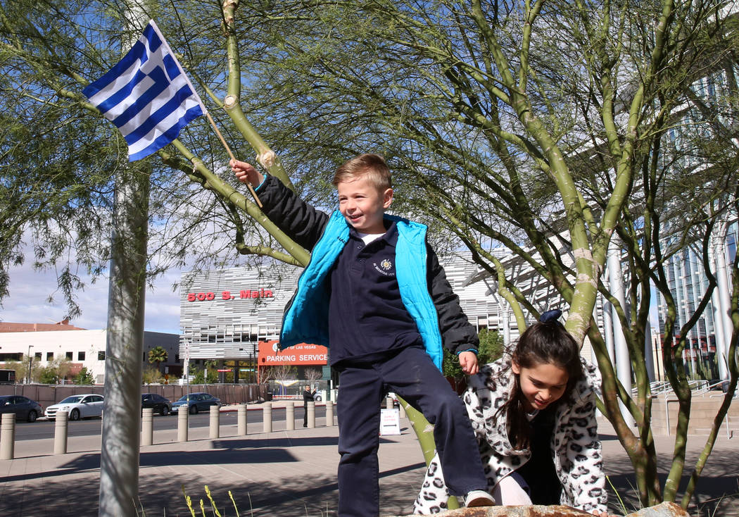 Jerry Georgiadis, 5, waves the flag of Greece as he plays with his sister Anastasia, 7, prior to the start of the Greek Independence Day with a flag raising ceremony outside the City Hall on Thurs ...