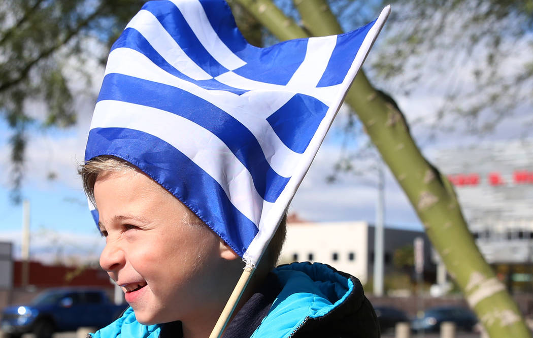 Jerry Georgiadis, 5, plays while holding the flag of Greece prior to the start of the Greek Independence Day with a flag raising ceremony outside the City Hall on Thursday, March 23, 2017, in Las  ...