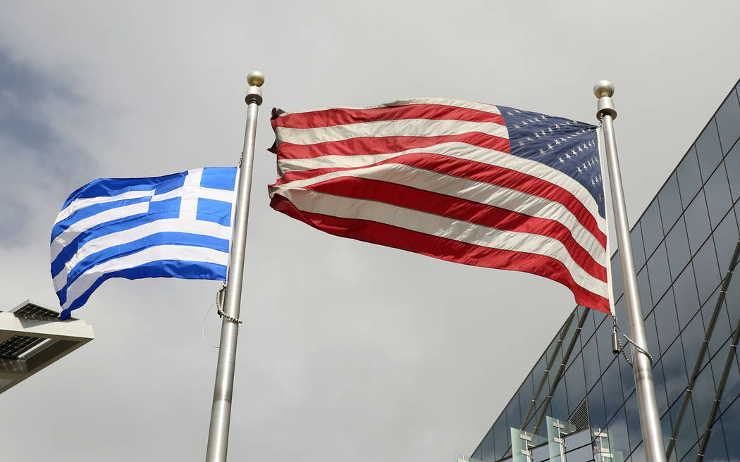 The Greek and U.S. flags fly during the Greek Independence Day outside the City Hall on Thursday, March 23, 2017, in Las Vegas. (Bizuayehu Tesfaye/Las Vegas Review-Journal) @bizutesfaye