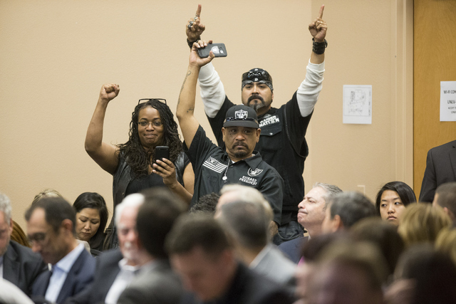 Fans show support  during a meeting with Oakland Raiders, local government and UNLV officials to discuss a proposed Las Vegas dome stadium at the Stan Fulton Building at UNLV on Thursday, April 28 ...