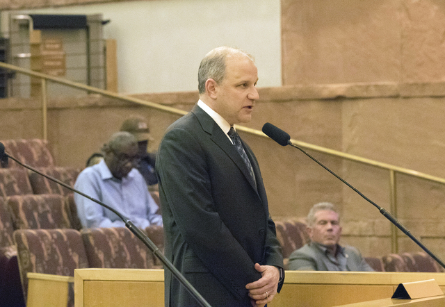 Oakland Raiders president Marc Badain reassures the Las Vegas Stadium Authority Board that the team is still committed to relocating at the Clark County Commission Chambers in Las Vegas on Feb. 9, ...