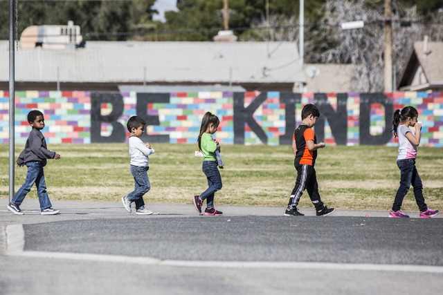 Kindergarten students walk across the playground to class at Arturo Cambeiro Elementary School on Wednesday, Feb. 15, 2017, in Las Vegas.  (Benjamin Hager/Las Vegas Review-Journal) @benjaminhphoto