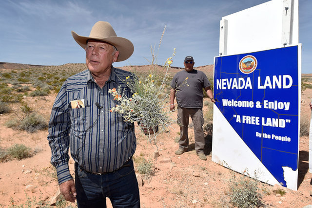 Rancher Cliven Bundy, currently in federal custody, displays a bouquet of desert foliage, the type his cattle graze on, during a news conference near his Bunkerville ranch in April 2015. (David Be ...