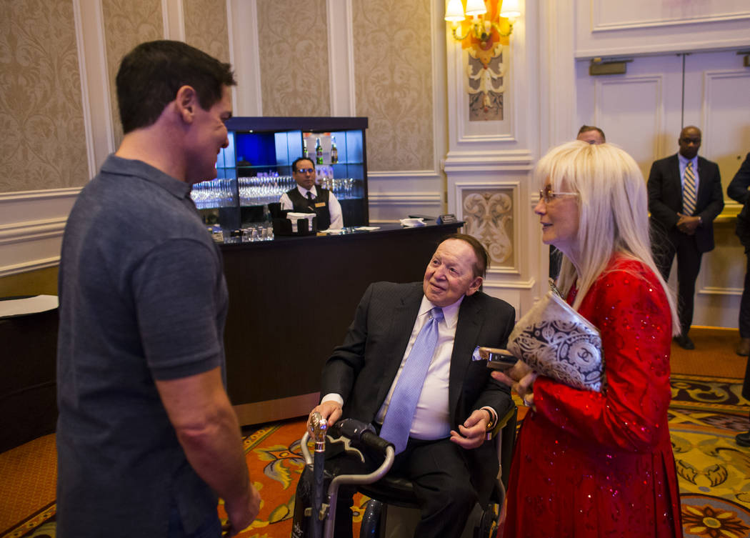 Entrepreneur Mark Cuban, left, greets Las Vegas Sands Corp. Chairman and CEO Sheldon Adelson and Dr. Miriam Adelson before attending the Adelson Educational Campus' 13th annual In Pursuit of Excel ...