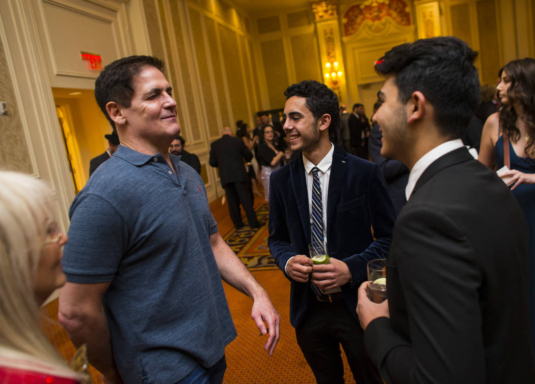 Entrepreneur Mark Cuban, left, talks with Kevin Larian and David Poura while  attending the Adelson Educational Campus' 13th annual In Pursuit of Excellence Gala at The Venetian hotel-casino in La ...