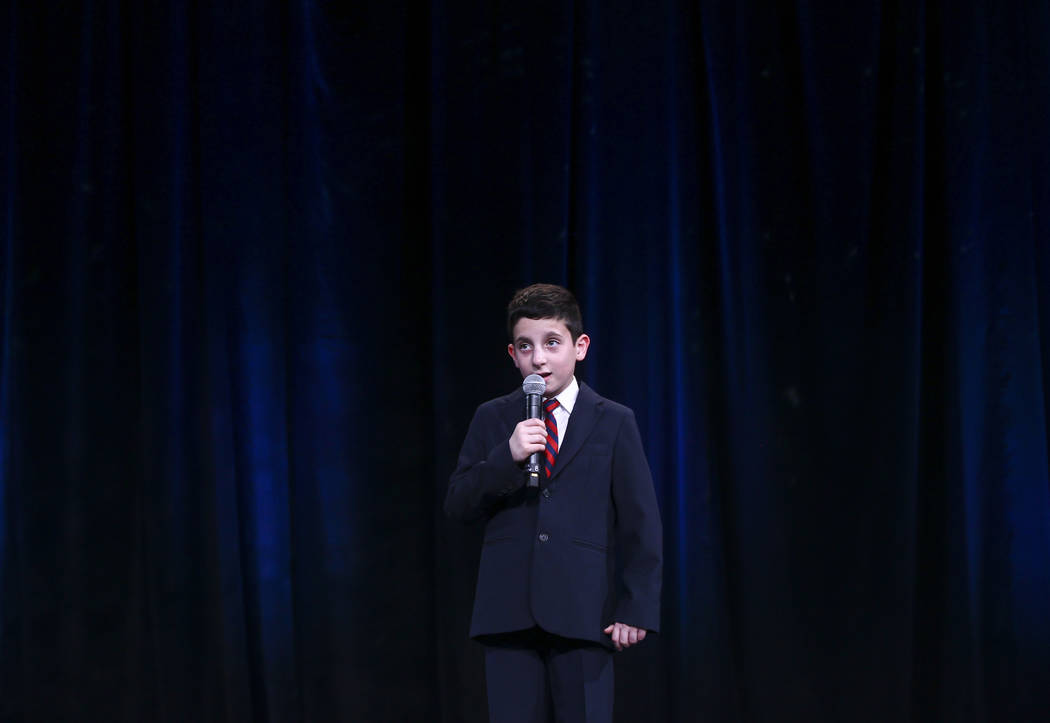 Addison Educational Campus fifth grader Riley Bello sings the national anthem during the Adelson Educational Campus' 13th annual In Pursuit of Excellence Gala at The Venetian hotel-casino in Las V ...