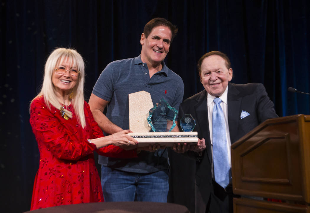 Entrepreneur Mark Cuban, center, poses with Dr. Miriam Adelson and Las Vegas Sands Corp. Chairman and CEO Sheldon Adelson during the Adelson Educational Campus' 13th annual In Pursuit of Excellenc ...