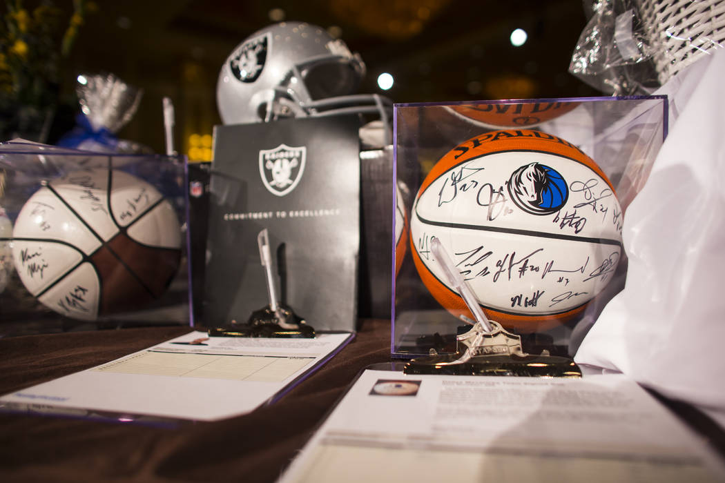 A ball signed by members of the Dallas Mavericks is shown at the silent auction during the Adelson Educational Campus' 13th annual In Pursuit of Excellence Gala at The Venetian hotel-casino in Las ...