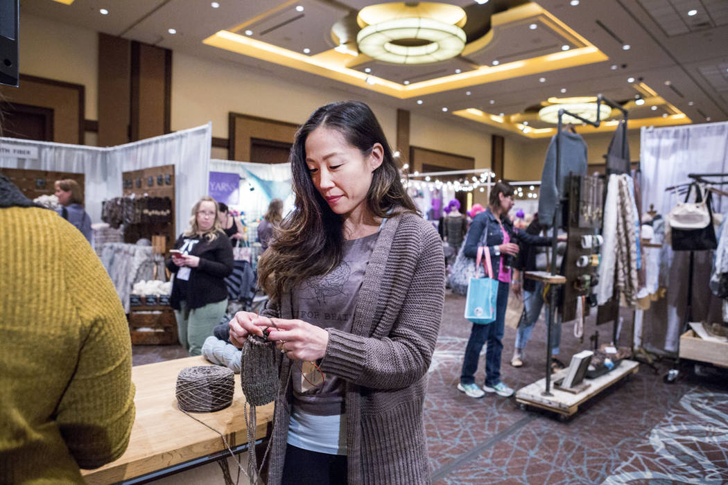Jenny Blumenstein knits at the Yoth Yarns booth during Vogue Knitting Live at the Red Rock Resort in Las Vegas, Sunday, March 25, 2017. (Elizabeth Brumley/Las Vegas Review-Journal) @EliPagePhoto