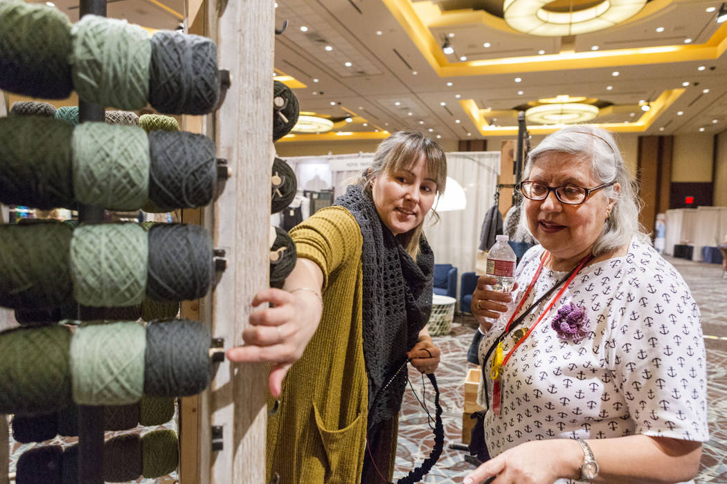 Yoth Yarns co-owner Veronika Job discusses different yarns with Vogue Knitting Live attendee Dianna Merchant at the event held at Red Rock Resort in Las Vegas, Sunday, March 25, 2017. (Elizabeth B ...