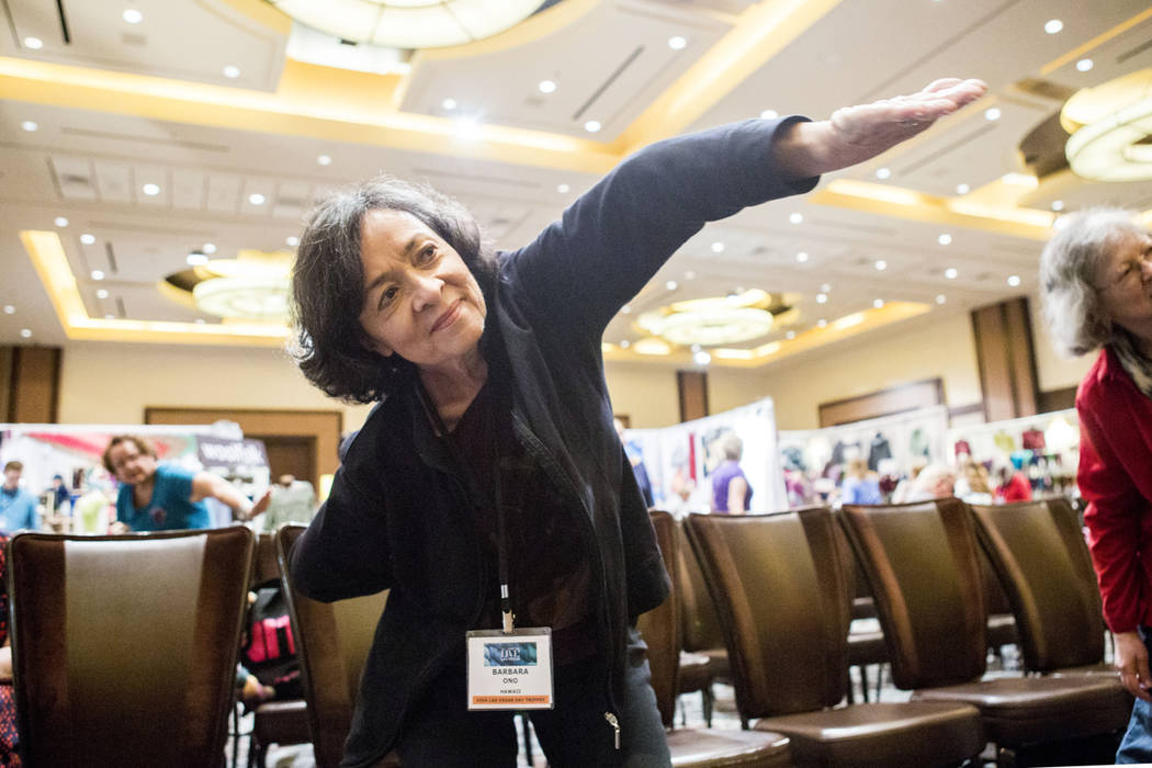Vogue Knitting Live attendee Barbara Ono partakes in a seated yoga session during the event held at the Red Rock Resort in Las Vegas, Sunday, March 25, 2017. (Elizabeth Brumley/Las Vegas Review-Jo ...