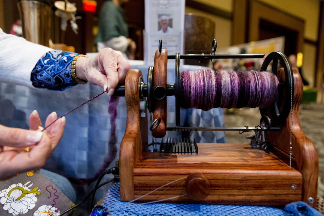 Terry Yocom makes a blend of camel, yak and silk yarn at her booth during Vogue Knitting Live at the Red Rock Resort in Las Vegas, Sunday, March 25, 2017. (Elizabeth Brumley/Las Vegas Review-Journ ...