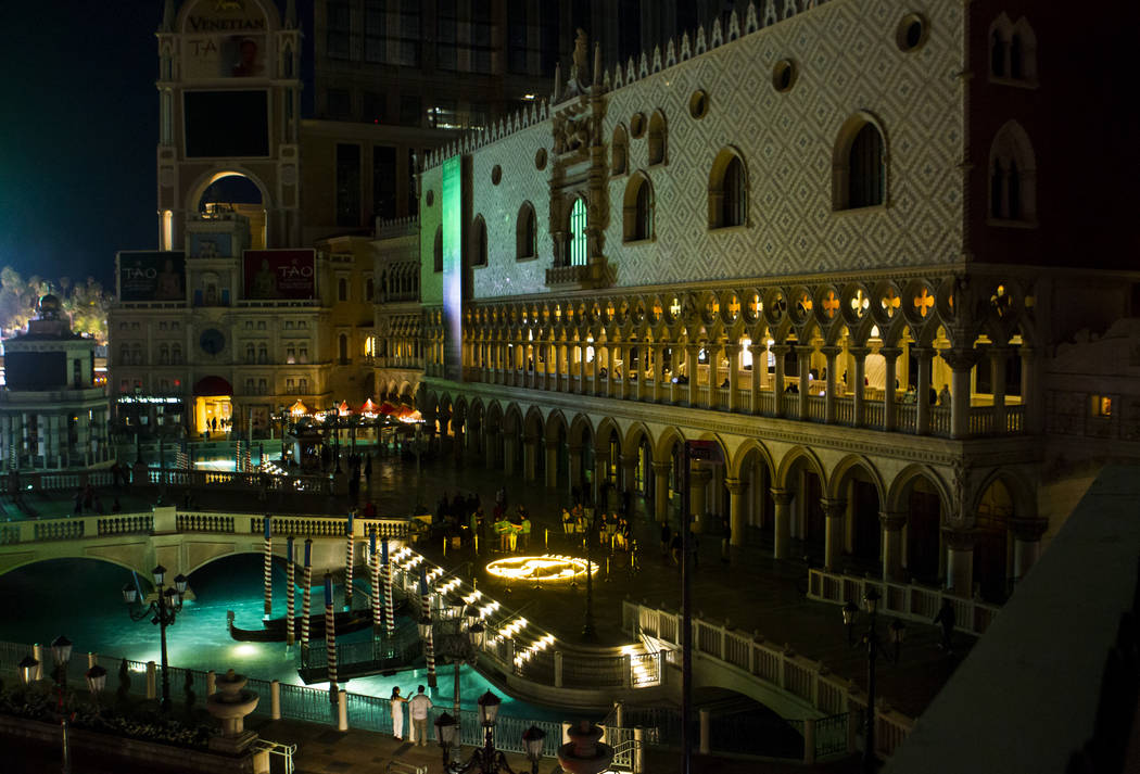 """A """"mural"""" of LED tea lights depicts Earth as the Venetian hotel-casino commemorates Earth Hour by turning off exterior lighting, rooftop signage and facade features for one hour  ..."""