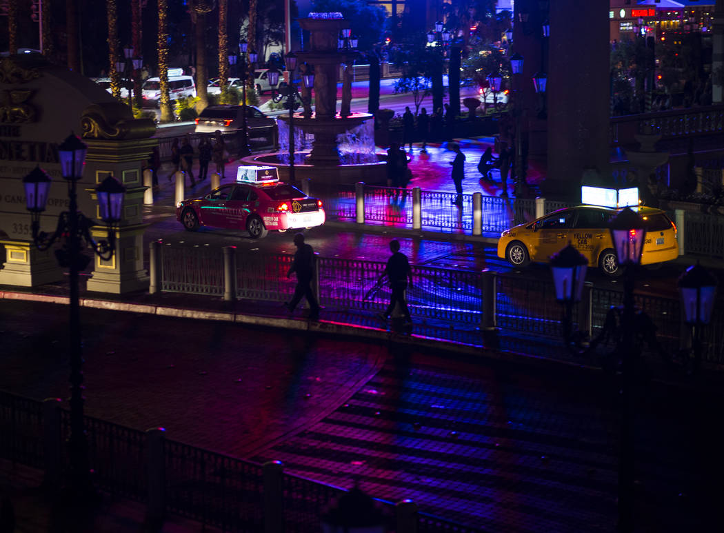 Traffic lights up the Las Vegas Strip as the Venetian hotel-casino, along with other Strip properties, commemorates Earth Hour by turning off exterior lighting, rooftop signage and facade features ...