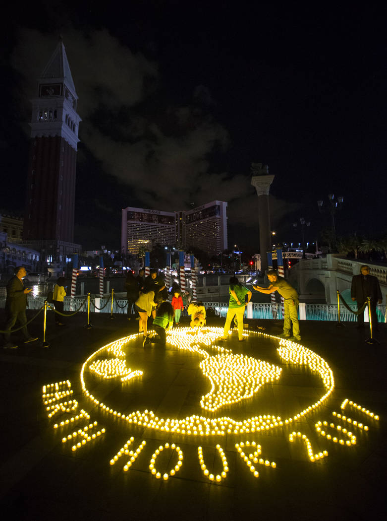"A ""mural"" of LED tea lights depicts Earth as the Venetian hotel-casino commemorates Earth Hour by turning off exterior lighting, rooftop signage and facade features for one hour  ..."