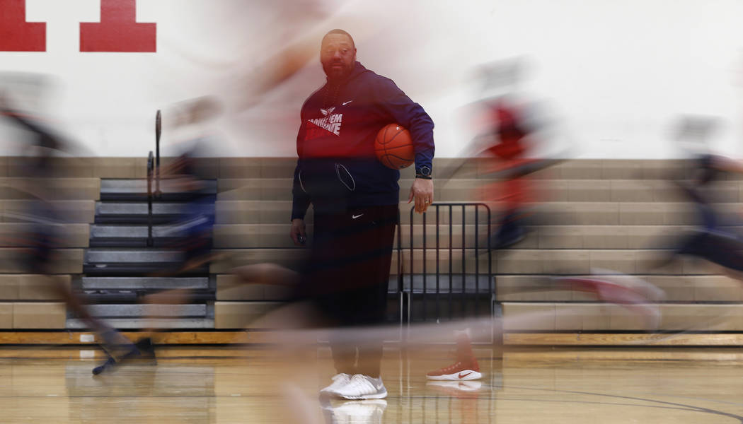 Findlay Prep's Head Coach Paul Washington watches as the team run laps during practice at the Henderson International School on Friday, March 24, 2017, in Henderson. Washington is also the  ...