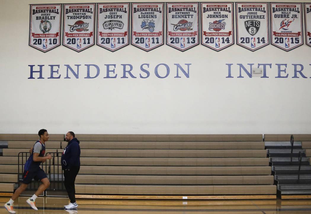 Findlay Prep's P.J. Washington, left, runs a lap as Head Coach Paul Washington watches at the Henderson International School on Friday, March 24, 2017, in Henderson. Coach Washington is als ...