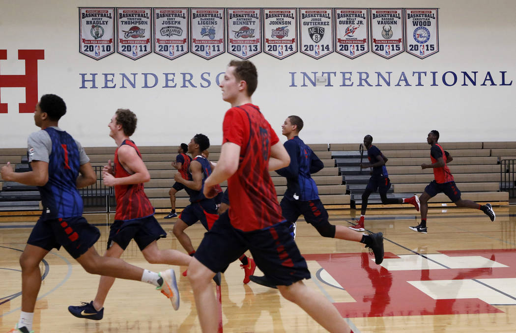 Findlay Prep's P.J. Washington (1) leads a lap as his teammates practice at the Henderson International School on Friday, March 24, 2017, in Henderson. Posters hang from the wall paying hom ...