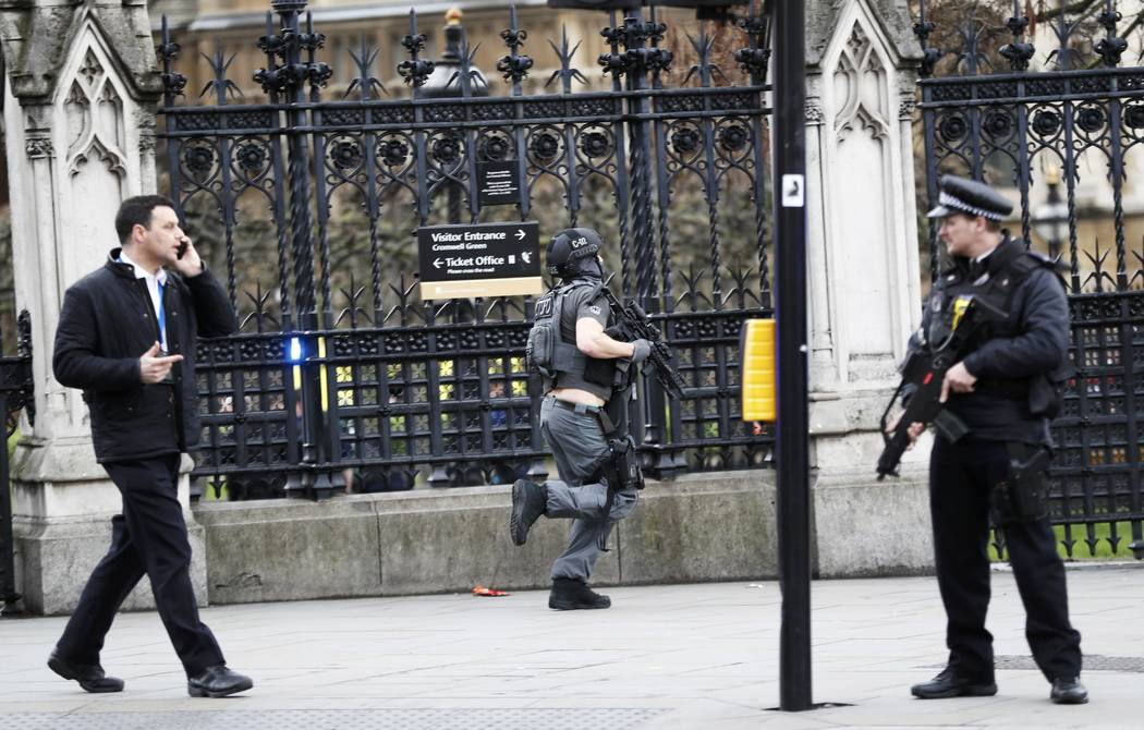 Armed police respond outside Parliament in London, Britain March 22, 2017.  (Stefan Wermuth/Reuters)