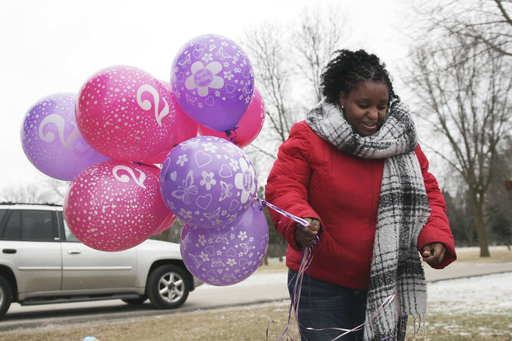 APIn this Jan. 27, 2017, photo, Helen Jackson brings balloons to the grave of her daughter, Cataleya Tamekia-Damiah Wimberly, at Graceland Cemetery in Milwaukee, before releasing them in honor of  ...