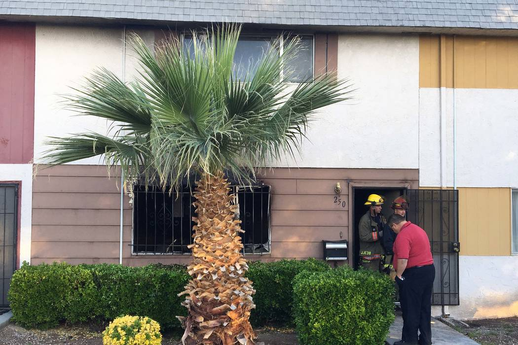 One person was hospitalized after a townhouse fire at 250 Greenbriar Townhouse Way in east Las Vegas, early Thursday, March 23, 2017. (Bizuayehu Tesfaye/Las Vegas Review-Journal) @bizutesfaye