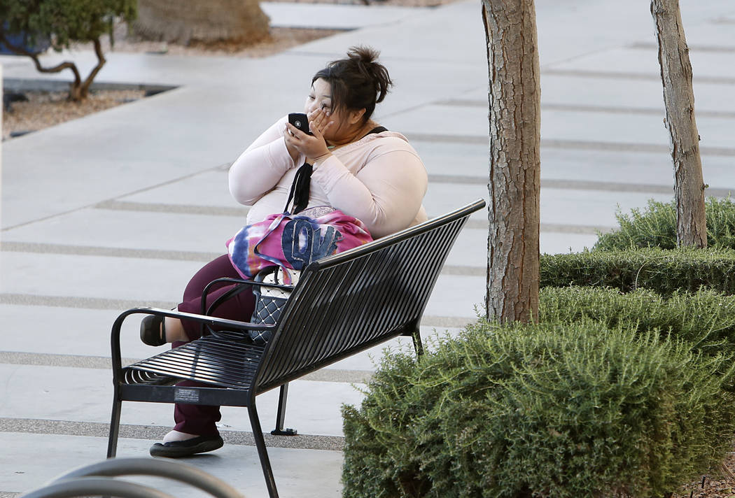 A woman who didn't want to give her name applies her face makeup while siting on Third Street on Thursday, March 23, 2017, in Las Vegas. (Bizuayehu Tesfaye/Las Vegas Review-Journal) @bizutesfaye
