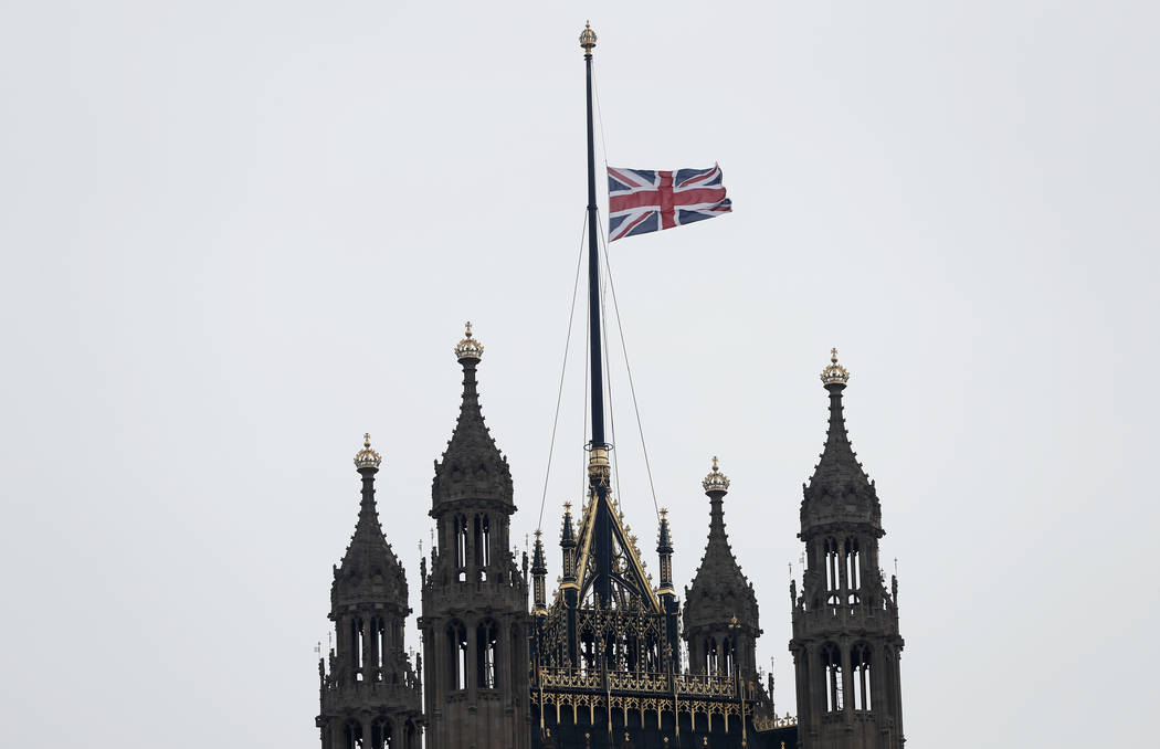 The flag flies at half staff above The House of Lords following Wednesday's attack in London, Thursday March 23, 2017. On Wednesday a knife-wielding man went on a deadly rampage, first  driving a  ...