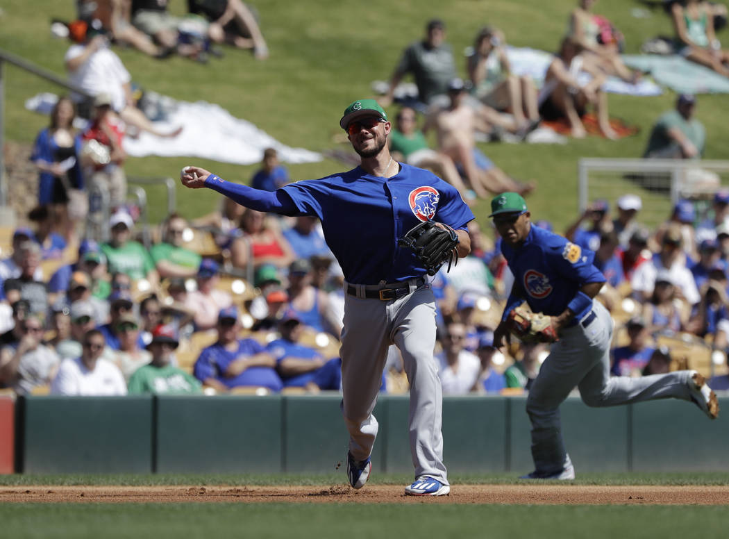 Chicago Cubs' Kris Bryant throws during a spring training baseball game against the Chicago White Sox, Friday, March 17, 2017, in Phoenix. (AP Photo/Darron Cummings)