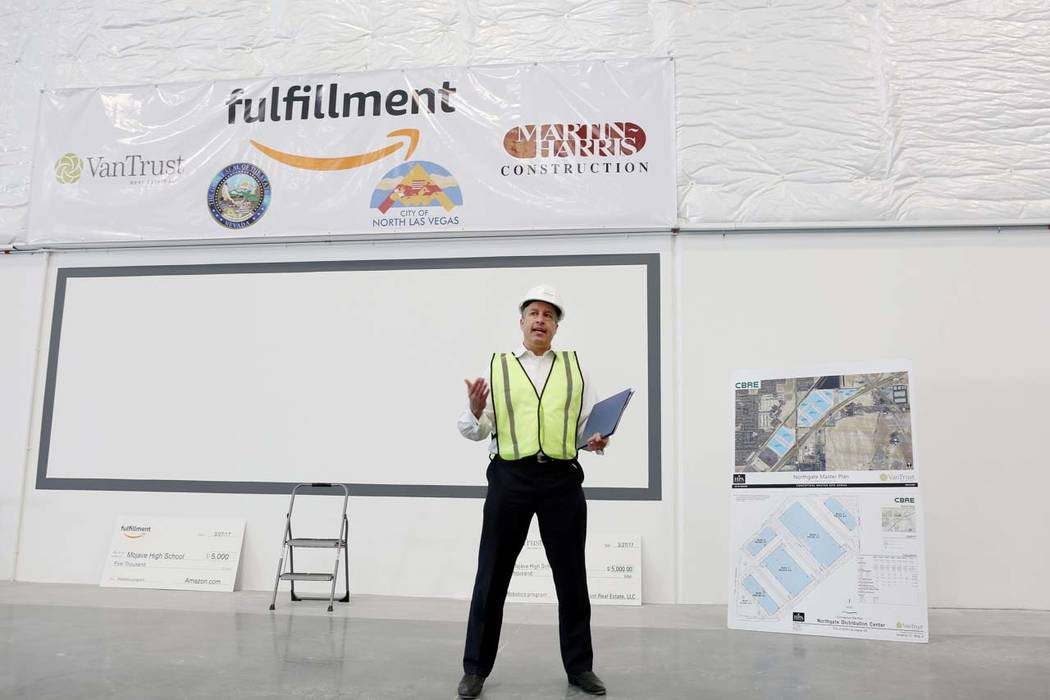 Gov. Brian Sandoval welcomes Amazon to North Las Vegas during a tour given of the newest Amazon warehouse that is under construction at Apex Industrial Park, Monday, March 27, 2017. (Elizabeth Bru ...