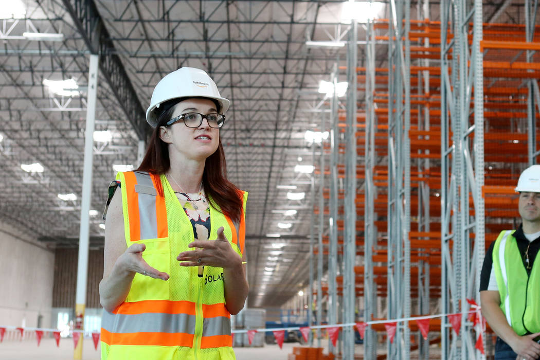 Amazon spokesperson Ashley Robison gives a tour of the newest Amazon warehouse that is under construction at Apex Industrial Park in North Las Vegas, Monday, March 27, 2017. (Elizabeth Brumley/Las ...