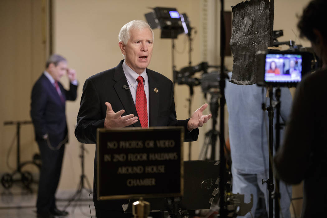 Rep. Mo Brooks, R-Ala., a member of the conservative Freedom Caucus responds during a TV interview on Capitol Hill in Washington, Thursday, March 23, 2017, as recalcitrant GOP lawmakers are being  ...