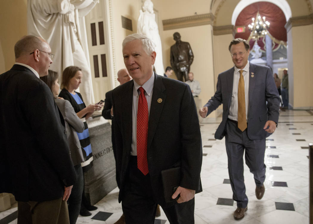 Rep. Mo Brooks, R-Ala., left, and Rep. Dave Brat, R-Va., members of the conservative Freedom Caucus, leave Capitol Hill in Washington, Thursday, March 23, 2017, to meet with President Donald Trump ...