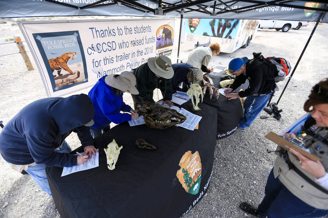 Volunteers sign up to help clean trash while surrounded by fossils at Tule Springs Fossil Beds National Monument in Las Vegas on Saturday, March 4, 2017, in Las Vegas. (Brett Le Blanc/Las Vegas Re ...