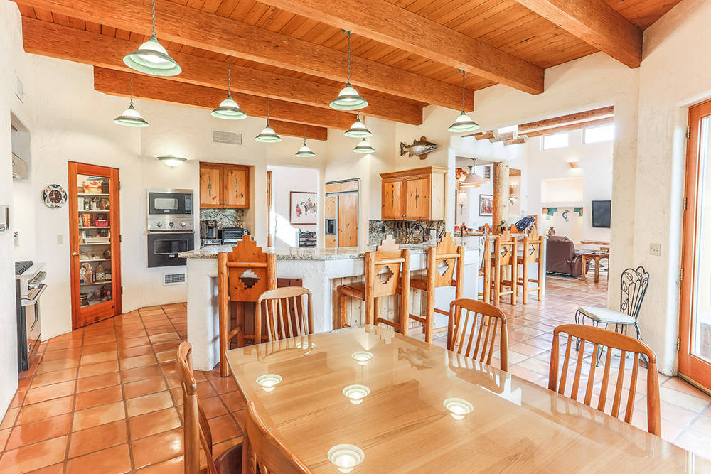 Courtesy of Avi Dan-Goor with Berkshire Hathaway HomeServices Nevada Properties There is a breakfast nook in the kitchen area. The kitchen has an eating bar.