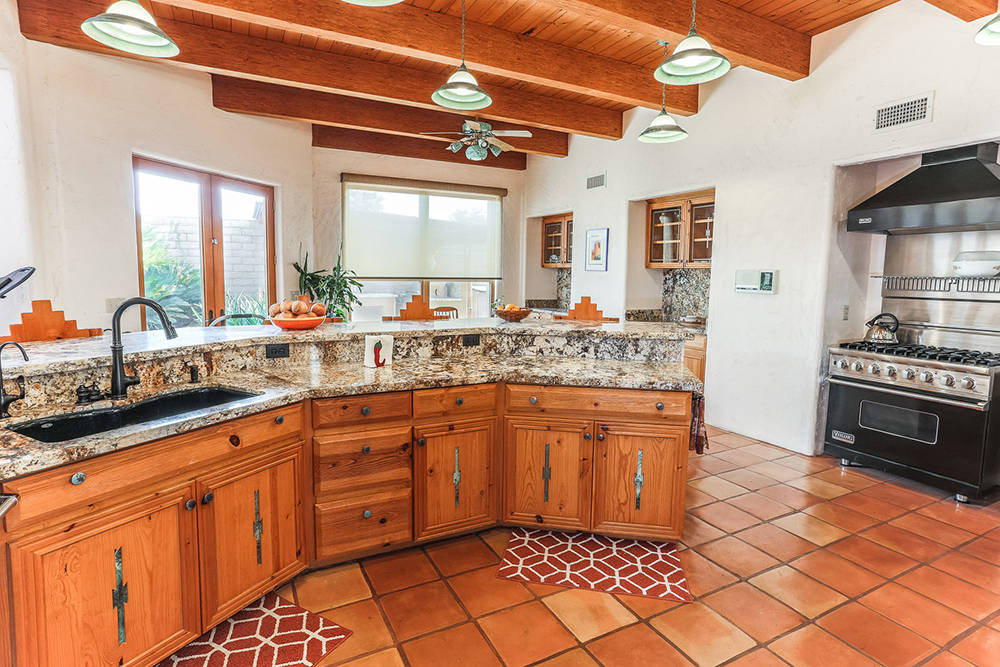Courtesy of Avi Dan-Goor with Berkshire Hathaway HomeServices Nevada Properties Mike and Michele Williams made a few changes to the original kitchen, which they renovated with granite countertops, ...