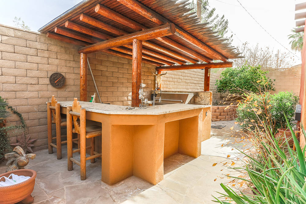 Courtesy of Avi Dan-Goor with Berkshire Hathaway HomeServices Nevada Properties The outdoor kitchen.