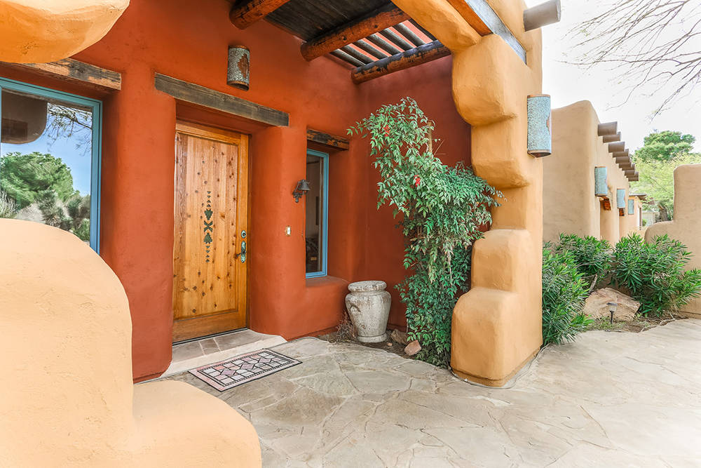 Courtesy of Avi Dan-Goor with Berkshire Hathaway HomeServices Nevada Properties The adobe-style home has all of the features of Sante Fe.