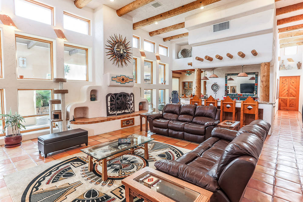 Courtesy of Avi Dan-Goor with Berkshire Hathaway HomeServices Nevada Properties The Southwestern style is evident in the living room, which has its own bar.